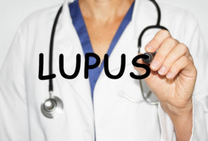 Doctor writing word Lupus with marker, Medical concept